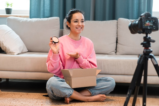 Blogger recording herself and showing unboxing