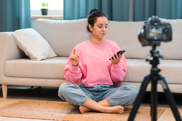 Blogger recording video at home