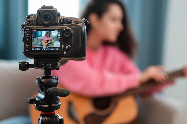 Blogger recording video with guitar lesson