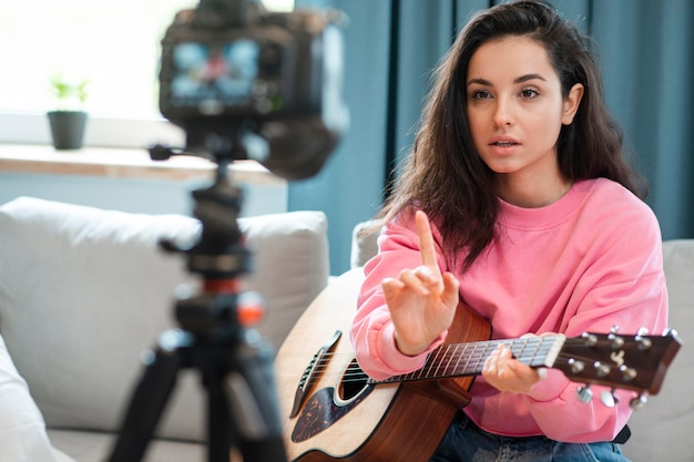 Blogger recording video with a guitar