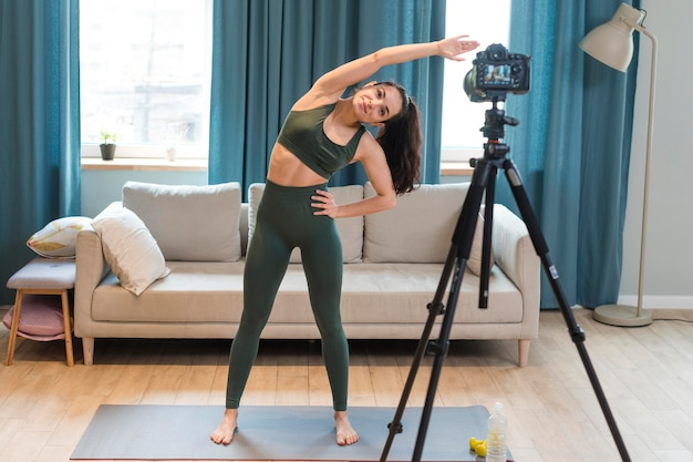 Blogger working out on camera