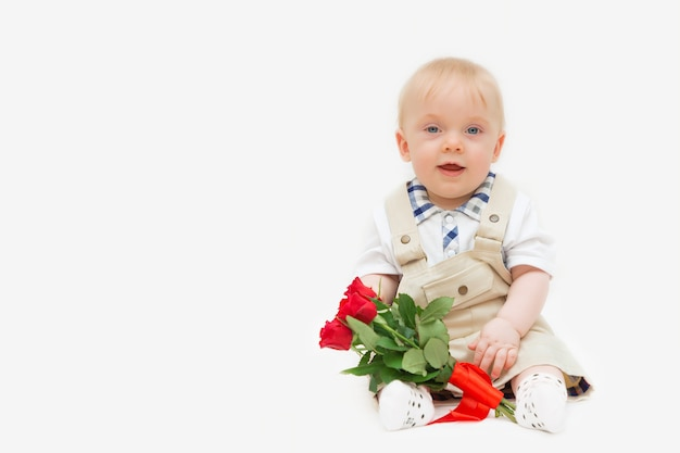 A blond boy gives flowers for mothers day