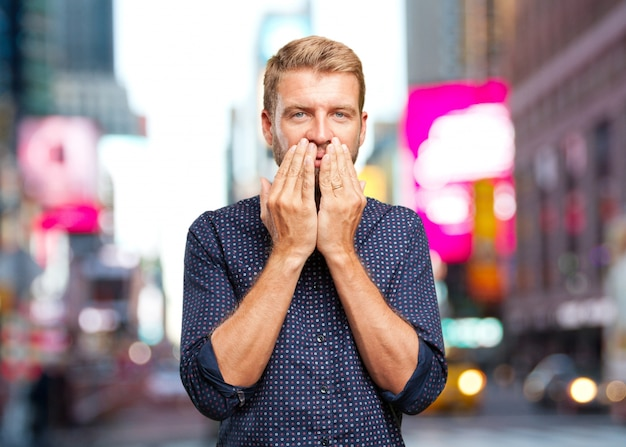 Blond businessman surprised expression