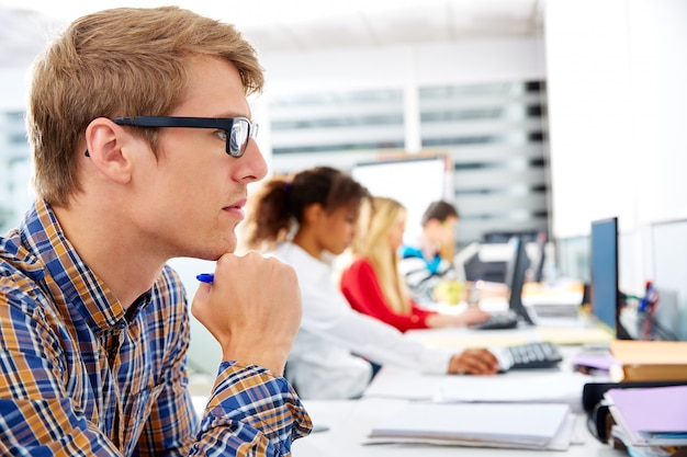 Blond businessman young in office with computer