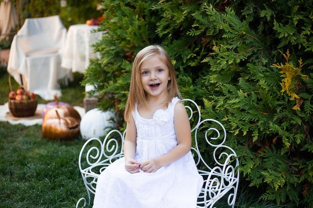 Blond child in bench in garden