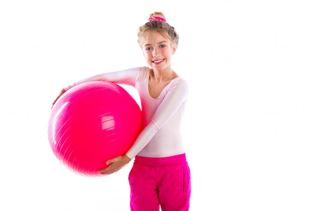 Blond fitness kid girls exercise swiss ball workout