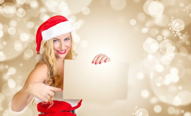 Blond girl dressed as santa claus