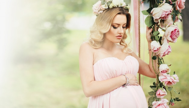 Blond happy outdoor love maternity