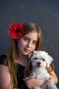 Blond kid girl and maltichon pet dog