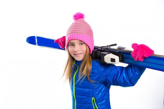 Blond kid girl winter snow holding ski equipment