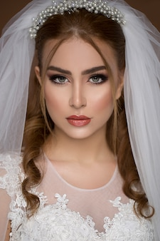 Blond model in wedding dress and bridal makeup