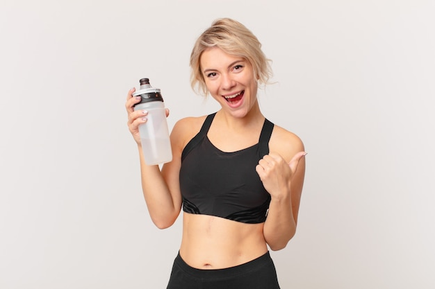 Blond pretty fitness woman with a water bottle