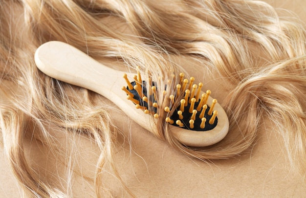 Blond wavy hair and care comb brush