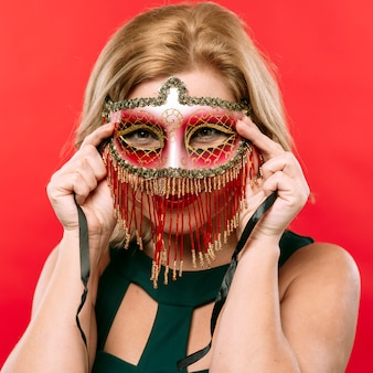 Blond woman in bright carnival mask