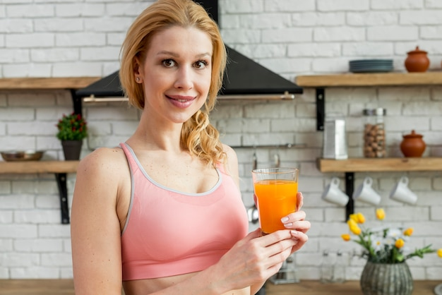 Blond woman drinking orange juice