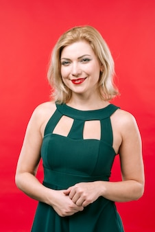 Blond woman in green dress smiling