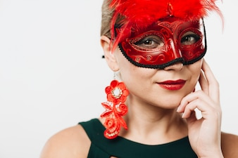 Blond woman in red carnival mask