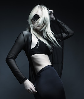Blond woman posing in black lingerie