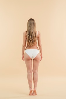 Blond woman with long hair wearing white lingerie