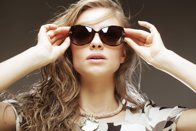 Blond woman with sunglases