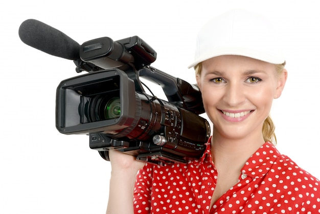 Blond young woman with professional video camcorder