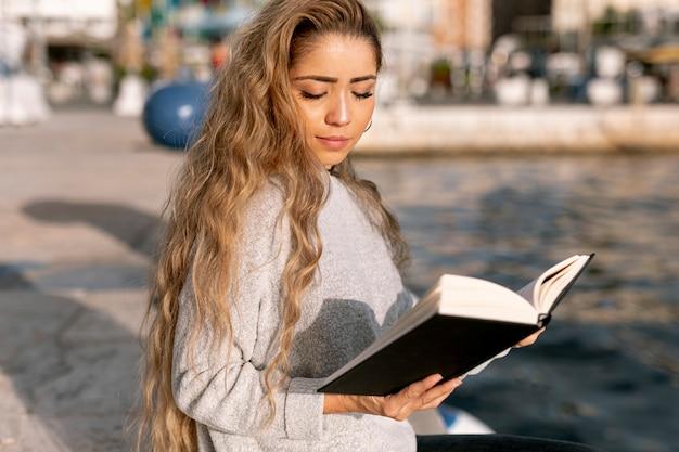 Blonde beautiful woman reading