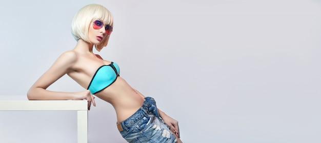 Blonde in blue leotard and leggings bright makeup