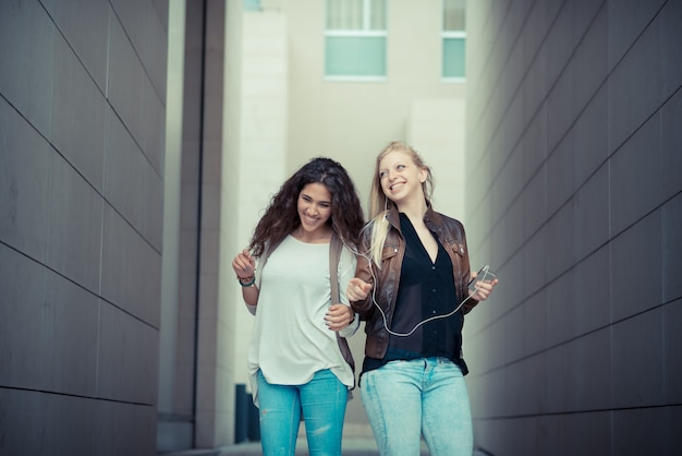 Blonde and brunette beautiful stylish young women