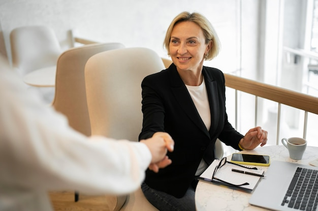 Blonde business woman working
