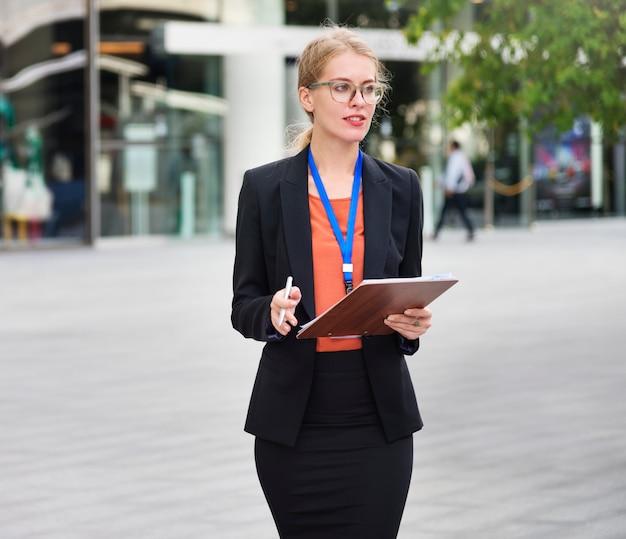 Blonde businesswoman on the go