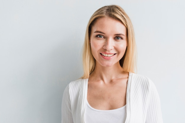 Blonde employee looking at camera on white background