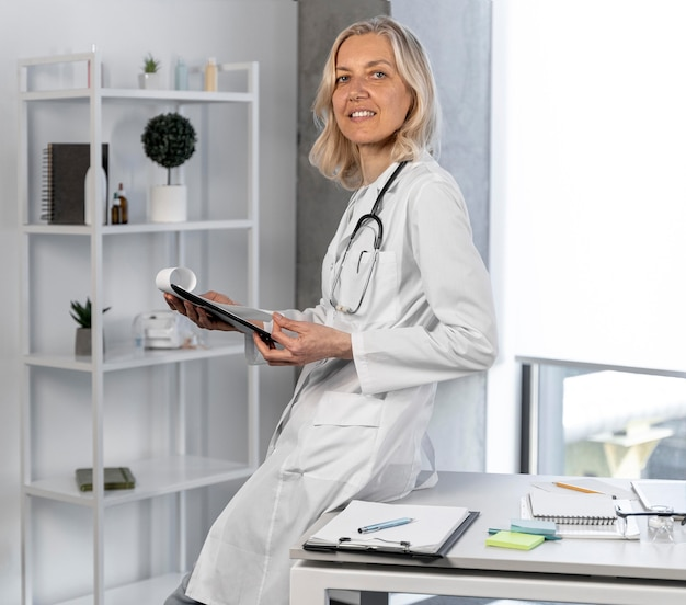 Blonde female doctor in her office