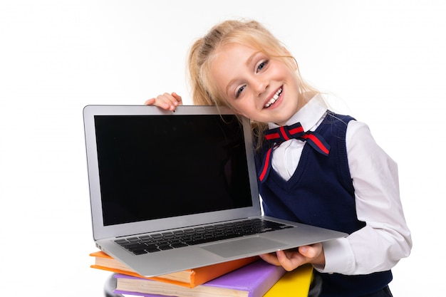 Blonde girl holds laptop with mockup on white wall