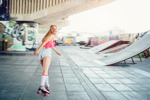 Blonde girl is rollerblading