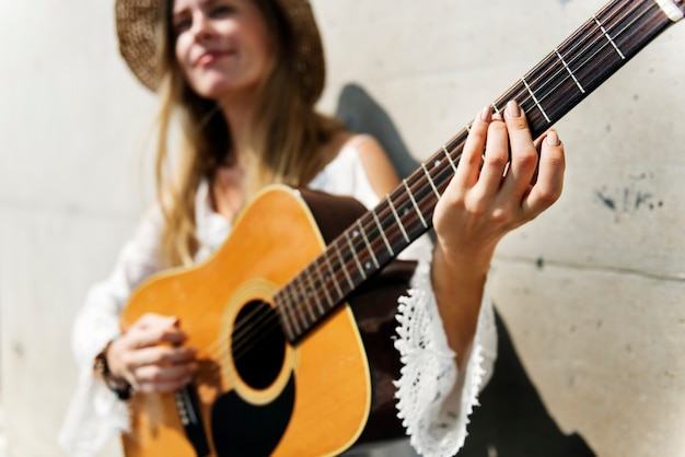 Blonde girl playing guitar concept
