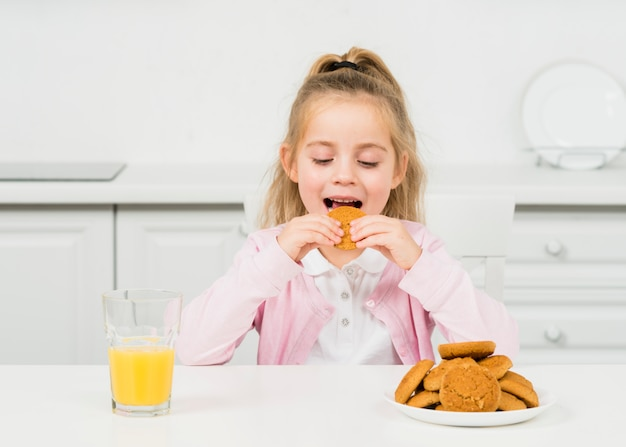 Blonde girl with cookies and juice