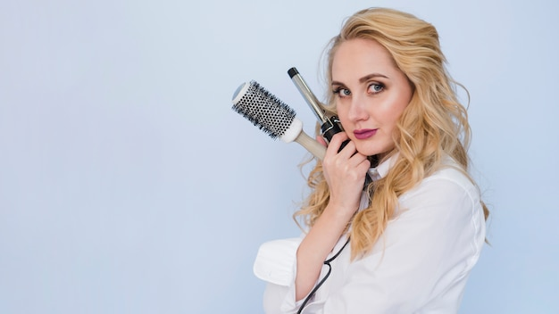 Blonde girl with hair brushes
