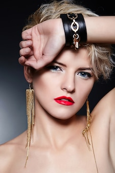 Blonde girl with red lips posing