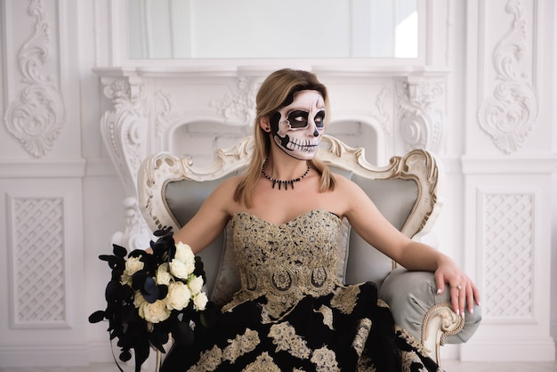 Blonde girl with sugar skull make. day of dead or halloween