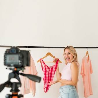 Blonde influencer recording fashion video