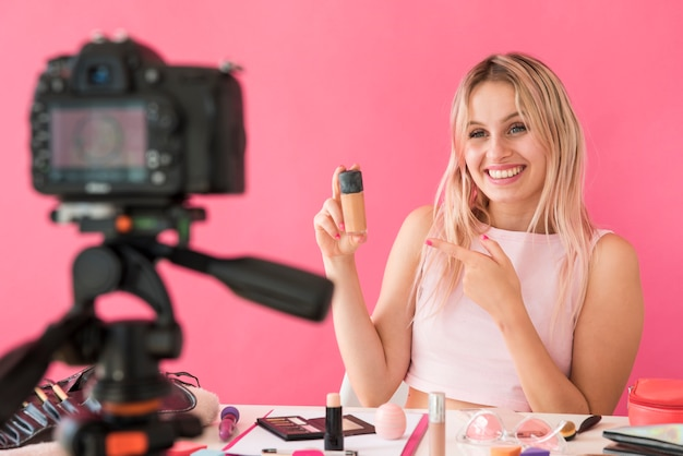 Blonde influencer recording make up video