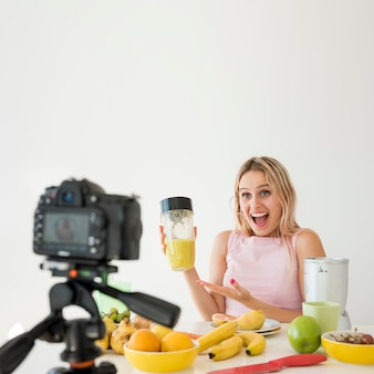 Blonde influencer recording nutrition food