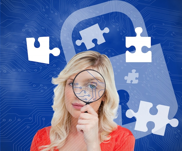 Blonde looking through magnifying glass