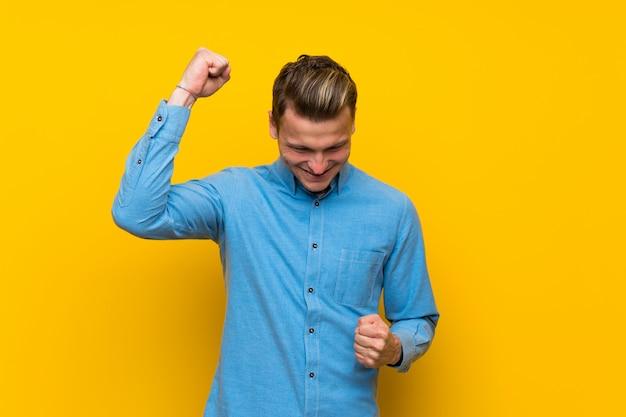 Blonde man celebrating a victory