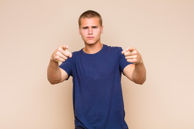 Blonde  man pointing with both fingers and angry expression, telling you to do your duty