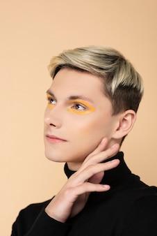 Blonde man wearing make-up