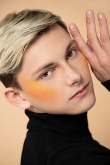 Blonde man wearing orange blush