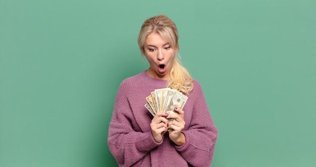 Blonde pretty woman with bills