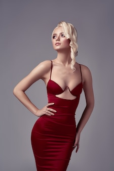 Blonde sexy young beauty woman in red dress