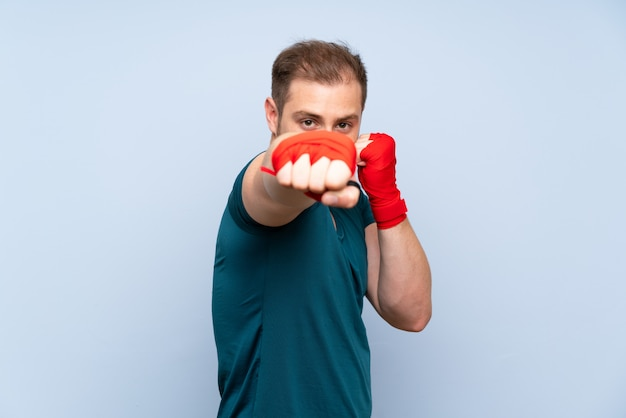 Blonde sport man in boxing bandages
